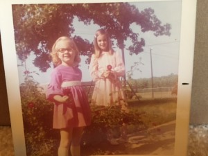 My sister and I in our childhood home's backyard
